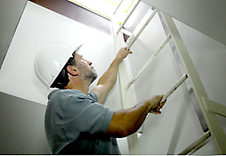 Maine Commercial & Industrial Photography - Inspection Worker on Ladder