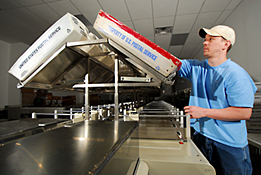 Maine Commercial & Industrial Photography - Mail Sorting Machine and Postal Employee
